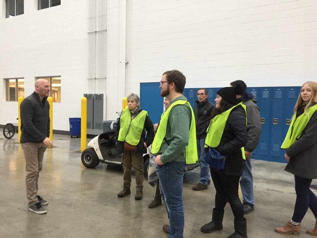 ERC trainees smiling on a process tour.